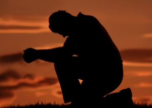 fader-praying-on-one-knee